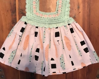 Mint green and pink feather print dress with crochet bodice size 0-3 months.