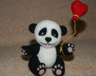 Panda. A toy made of wool.