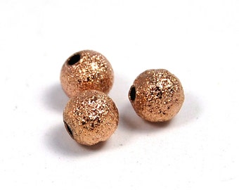 100 beads, 6mm Rose Gold Stardust Spacer beads