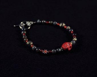 Red Skull and Black Bracelet