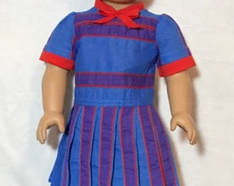 Cute sporty dress with stripes has a retro feel.