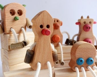 5 men in wood and locally harvested bamboo finish with ecological oil (Pinocchio, monkey, Octopus, cow and OWL)