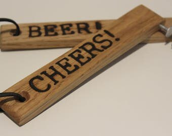 Handcrafted Oak bottle opener with rustic nail and leather cord