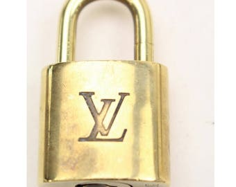 Louis Vuitton, lock. Authentic