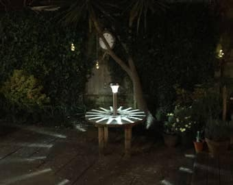 Recycled garden table with solar light attached