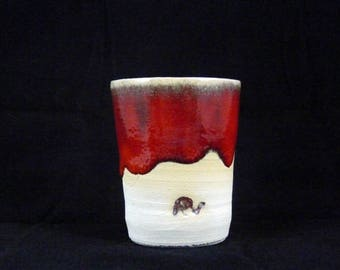 Red espresso cup, elephant