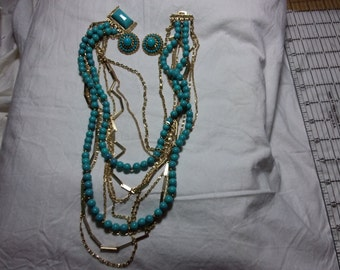Beautiful turquoise colored beads and gold tone multi strand Coro necklace and earring set