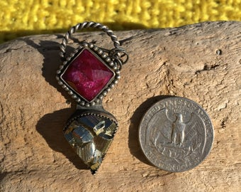 Two stone pyrite and ruby fine silver pendant.