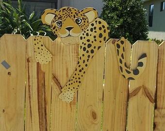 Jaguar Yard Art hangin' out on the fence!