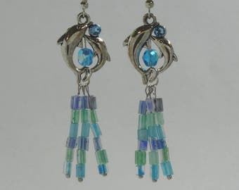 Silver dolphin dangle earring with Czech blue green and purple beads