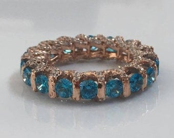 sterling silver rose gold plated blue topaz cz eternity band