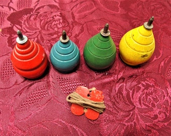 4 vintage wooden spinning tops with string