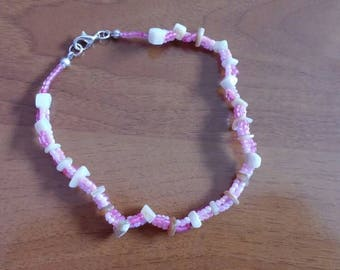 Beaded anklet with seashells in pink hues