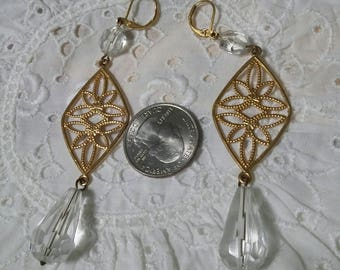 Long gold and crystal pierced earrings