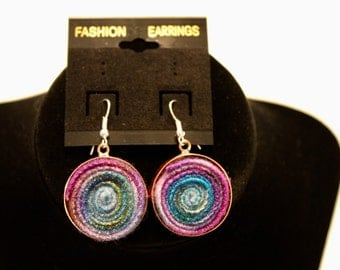 Rainbow colored dangle earrings.