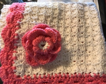 """White and pink infant girl blanket, with pink flower, dimensions are 27""""x19"""","""