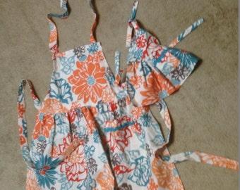 "Matching Child and 18"" flowered apron set"