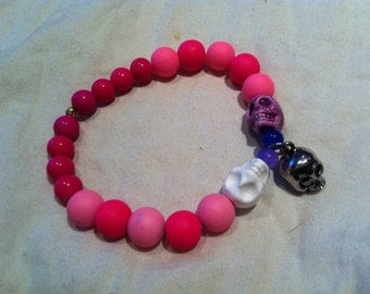 hand made glass and ceramic bead bracelets and necklaces w/ unique precious stone pendant or charm.