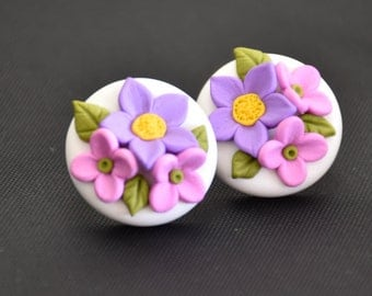 White floral stud earrings.