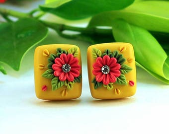 Yellow polymer clay stud.