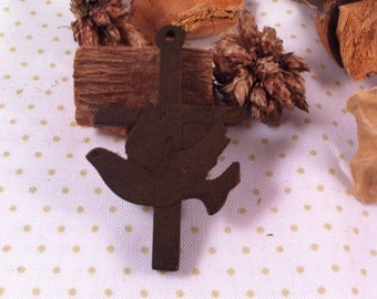 superb wooden cross finely decorated with a dove in the cross