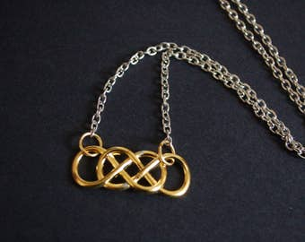 Gold tone infinity symbol necklace