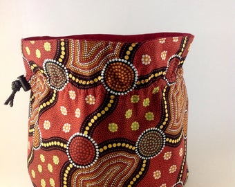 Drawstring bag made from Australian Aboriginal inspired fabric.