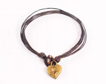 Multiple Cords Bracelet Featured Metal Bronze Heart Charm