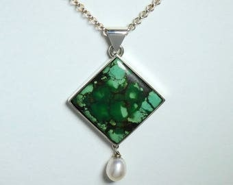 Turquoise, silver and freshwater pearl pendat on a silver necklace. Square convex shaped green turquoise freshwater pearl, silver pendant.