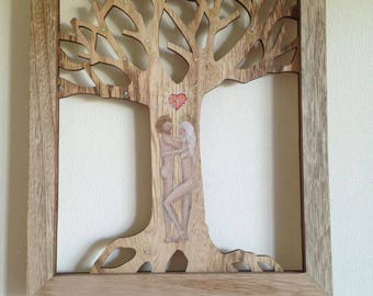 Unique handpainted wooden tree with a couple representing love