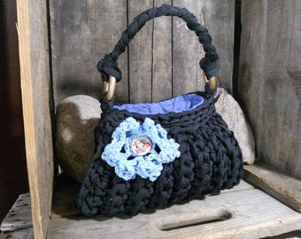 Handbag crocheted colored black. This bag is made of recycled material.