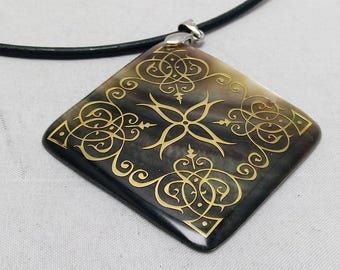 Romboid mother of pearl,pendant, leather necklace 17 inches, dark mother of pearl, bronze scroll design