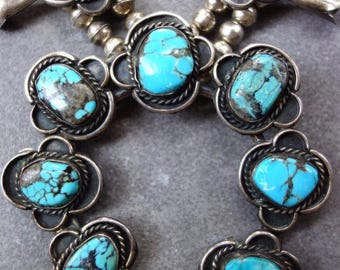 Squash blossom necklace. 166 grams of gorgeous bisbee turquoise and sterling silver. Old pawn! Very old.
