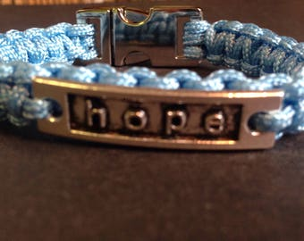 Paracord bracelet with hope charm.
