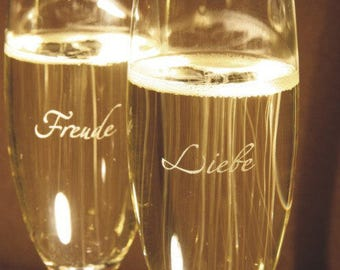 """2 champagne glasses, engraved with the words """"Love"""" and """"Joy"""""""