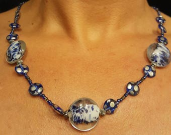 One of a kind crafted beaded feeling blue necklace with matching earrings.