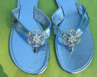 Blue sandals with silver Rhinestone button. Blue summer sandals with silver Rhinestone button. Blue beach sandals with silver button.
