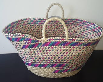 Hand made Berber basket in natural leaves. Ethnic Berber decoration.