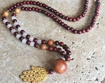 Rose quartz and sandalwood mala necklace with a golden hamsa pendant, 108 bead japa mala necklace