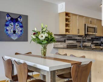 Beautiful concrete and live edge dining room table with reclaimed wood legs.