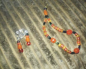 Orange and black necklace, bracelet and earings set
