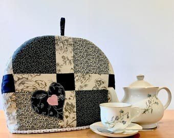 Handmade patchwork quilted tea cosy. Insulated and lined.