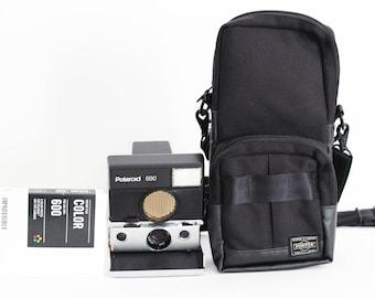 Collectible Piece: Polaroid 690 Silver  W/ Porter Bag