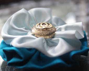 White and turquoise fabric flower