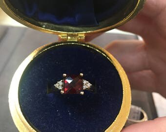 14ky cushion cut garnet and diamond ring