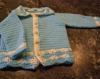 Blue and white shell crochet baby sweater