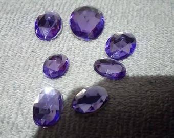lila oval shaped fake stone.