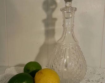 Vintage glass decanter with stopper.