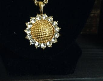 Nolan Miller signed Gold and Crystal Sunflower pendant