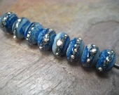 Tiny silvered spacers in denim (by-the-bead) glass beads